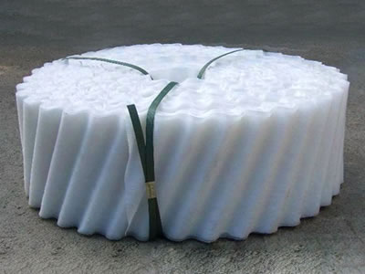 One roll of white cooling tower fills is shown on the picture, and it is packaged by dark green PE straps.